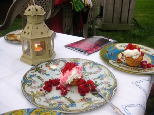 Dessert was raspberry cream cheese muffins topped with whipped cream and more raspberries from the garden.